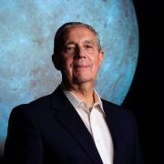 Photo of Jack Burns with SOS Moon in the background