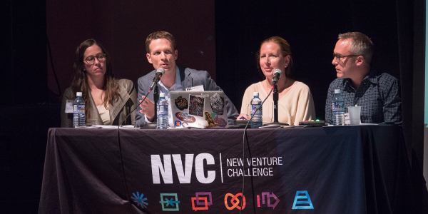 four judges onstage at NVC championships