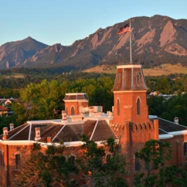 Old Main in spring Flatirons in background