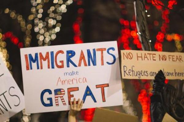 People holding up pro-immigrant signs during a rally