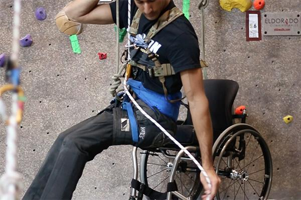 Student in a wheelchair on a climbing wall