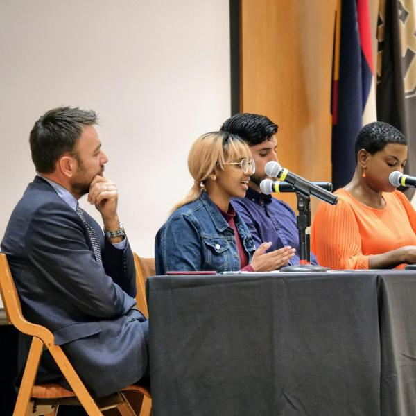 Panelists talking during the diversity and inclusion summit