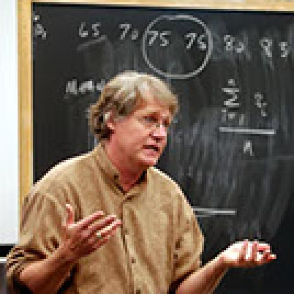 male professor lecturing class