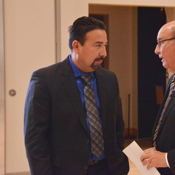 A speaker talking with Philip P. DiStefano, Chancellor