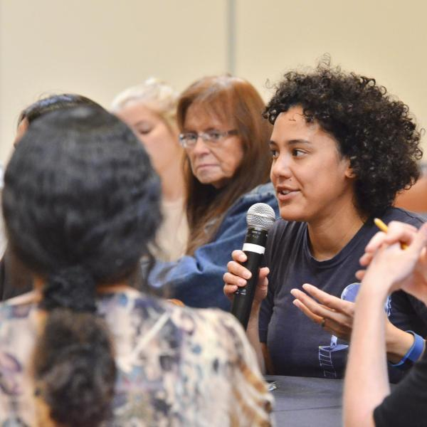 A person asking a question during the summit