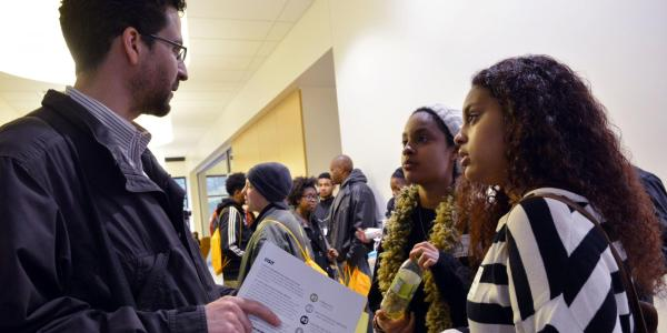 Staff talking to students