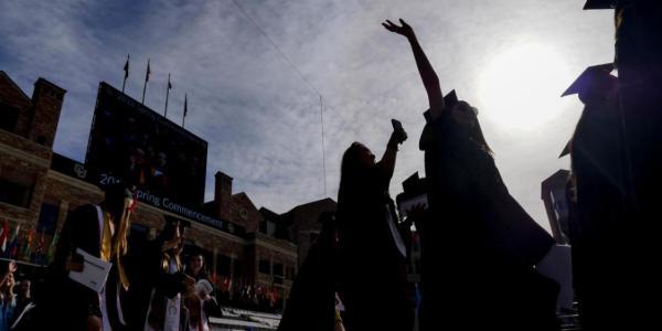Students throwing hats at graduation