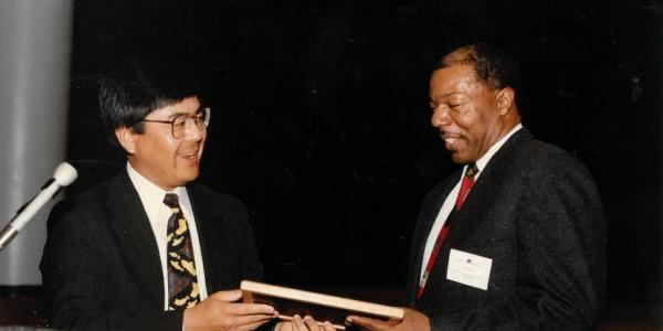 A young Alphonse Keasley receiving and award
