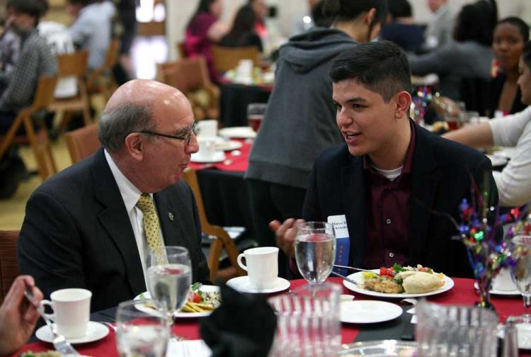 Chancellor talking with a student