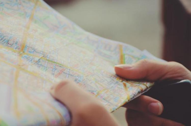 A persons hands holding a map