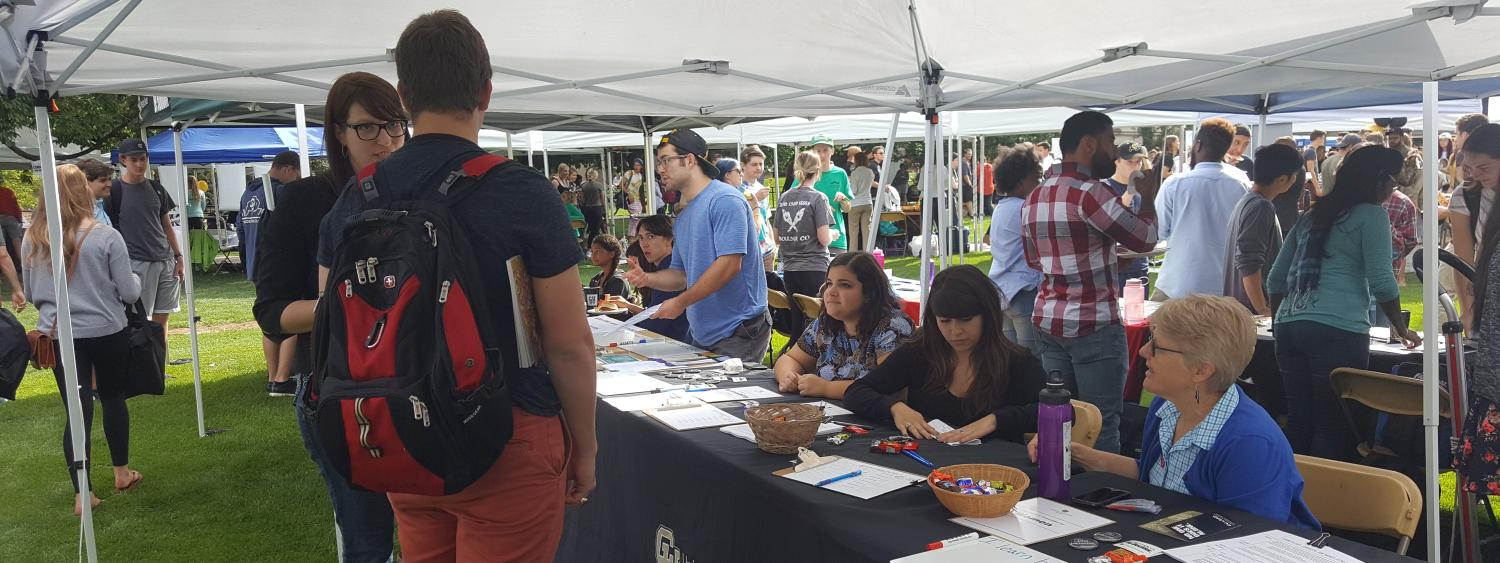 ODECE Staff talking to students at an event.