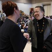 Eva Lacy, left, an academic advisor, introduces herself to Beverly Daniel Tatum following Daniel Tatum's conversation with University of Colorado Chancellor Phil DiStefano to kick off a two-day, system-wide summit on diversity and inclusion. (Cliff Grassmick / Staff Photographer)