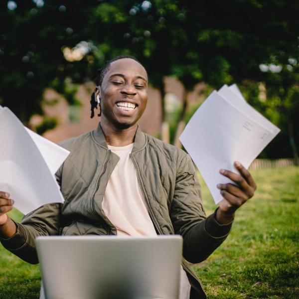 Happy Student in front of computer