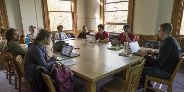 Group of students in discussion with a faculty member