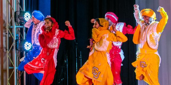 Students in costume dancing on international festival day