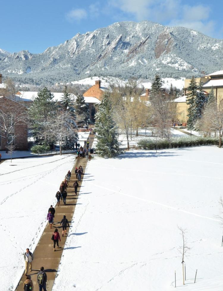 Campus in winter with students on path