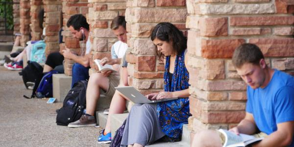 CU students studying outside the University Memorial Center.
