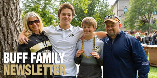 Buff family newsletter with family smiling at camera