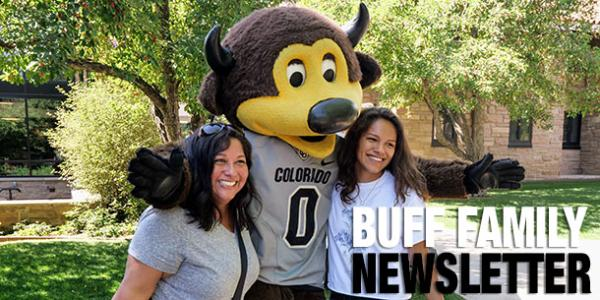 Buff family newsletter photo with Chip, a mother and a daughter smiling