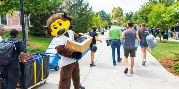 Chip helping students move in to the residence halls