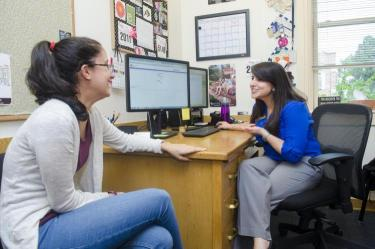 A student meets with their advisor