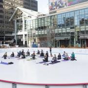 people doing yoga on ice
