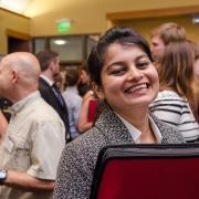 student smiling at camera at a career fair