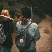 female friends walking in the woods