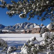 View of the CU Boulder engineering field, Koelbel building, C4C and Flatirons after snowfall.