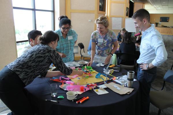 Outreach professionals at development workshop
