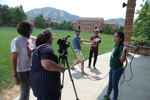 High schoolers gathering footage to make climate change films.