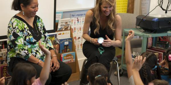 Theresa Martinez of the Navajo Nation with Beth Osnes explaining solar powered lights at University Hill Elementary School in Boulder.