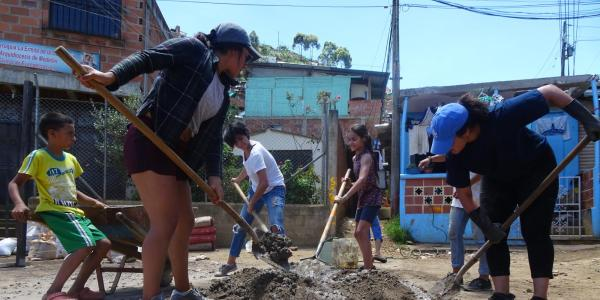 CU Boulder students and community members work at a Colombian settlement as part of an outreach project.