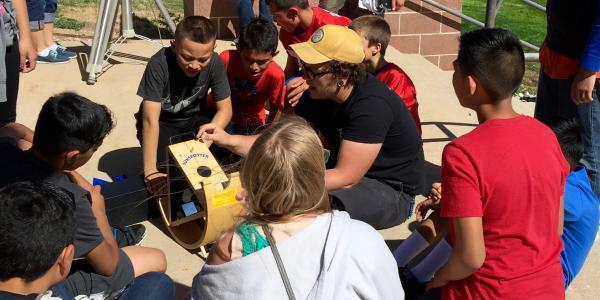 CU Boulder science students searching for sunspots with middle schoolers