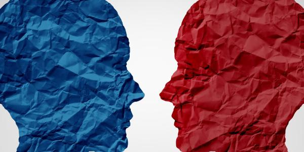 Paper red and blue heads face each other