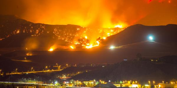 A wildfire encroaches on a town