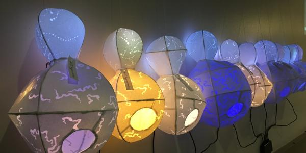 Lanterns that represent yeast in an art/science exhibit