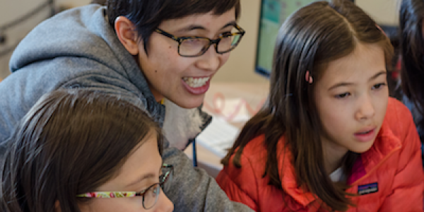 Ricarose Roque interacting with students at the Tinkering Studio located in the Exploratorium, San Francisco.
