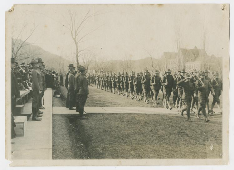 Student soliders at CU marching near Old Main during WWI