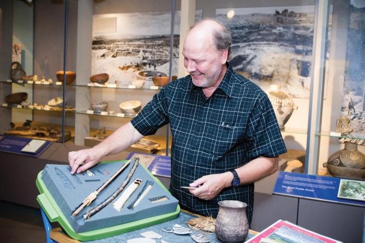 James Hakala shows of an archaeology kit