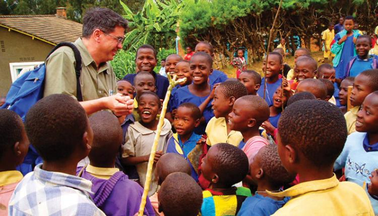 Bernard Amadei with kids in Africa