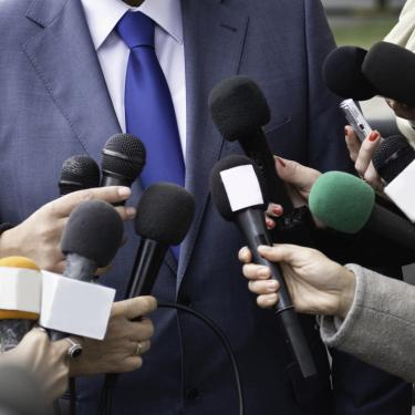 politician being interviewed by the press