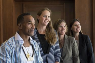Korey Wise, who was wrongly convicted as part of the Central Park Five, with his lawyer and law professors from CU Boulder.