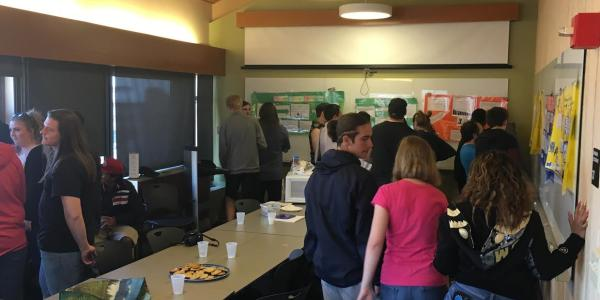 High school PISEC students participating in a poster symposium