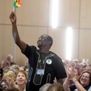 Bedzra Dela Quarcoo, of Ghana, waves to the crowd after he is introduced. Friendship Force International brought more than 400 international visitors to Boulder this week for its 2019 World Conference at University of Colorado Boulder.
