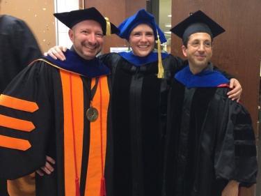 Noah Finkelstein, Bethany Wilcox, Steve Pollock in graduation gowns