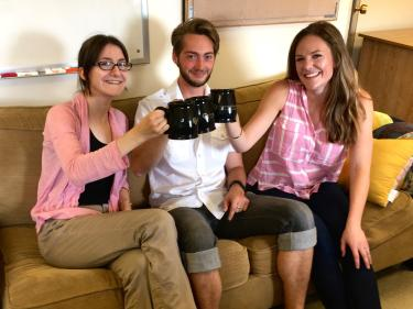 Allie Lau, Julian Gifford, Jessica Hoehn sitting on a couch with coffee mugs