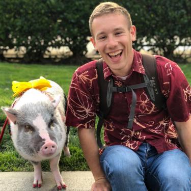 Giaco Corsiglia with a pig