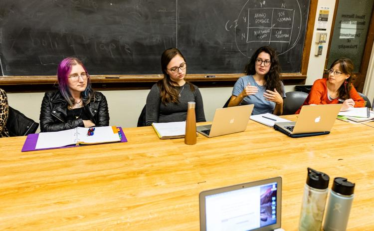 Graduate students in conference