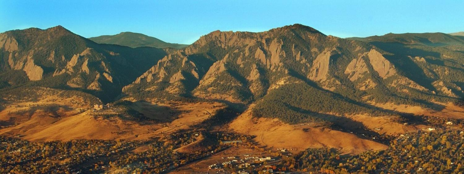Aerial photo of Boulder with mountains in background